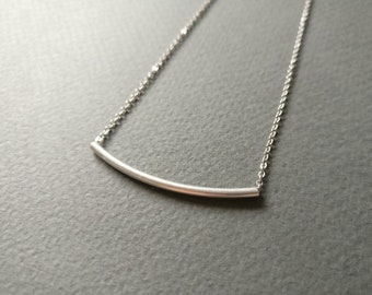 Simple dainty geometric line necklace.