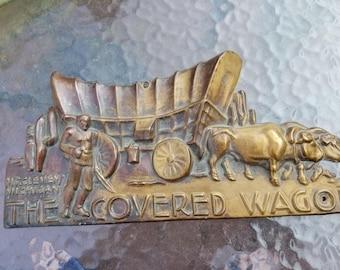 Vintage The Covered Wagon Mt Clemens MI Travel Camper Trailer Copper Emblem