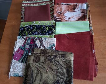 Bundle of fabric in greens and browns.