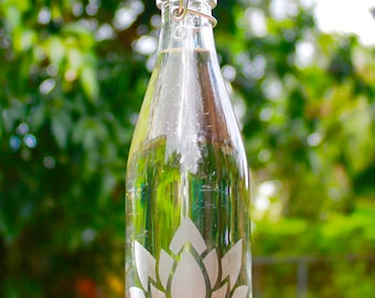 16oz. Etched Simple lotus design reusable glass water bottle with swing top lid