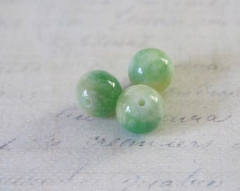 3 green and white 10mm yellow, marbled agate beads