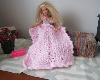 Barbie Afghan 6 1/2 inches x 7 inches. Hand crocheted with light pink yarn.