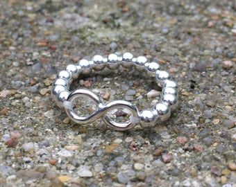 Silver infinity symbol ring.