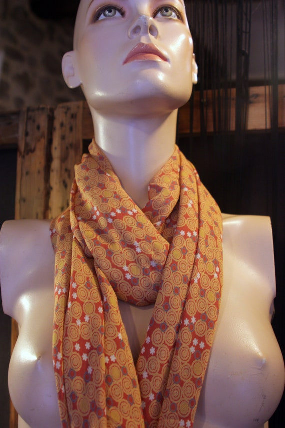Promo Studio space. Shawl, scarf, square Tangerine Orange with bubble pattern and grey/blue flowers