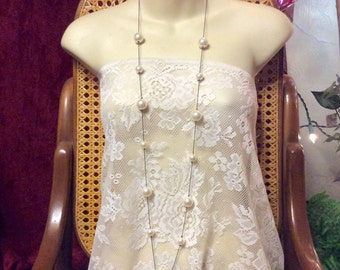 Vintage signed Express black metal chain large imitation pearls long necklace .
