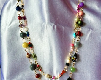 Custom made bead necklace made up of natural stone, glass, acrylic, wood, faceted and smooth.  Travel necklace that will go with anything.
