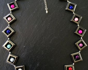 "16"" haematite and rainbow bead necklace with 2 1/2 sterling silver extension chain"