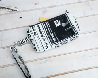 Wristlet   newspaper patterned fabric, newspaper, letters printed letters black and white