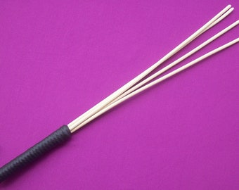 Cane Whip-4 rattan canes united to a spanking whip