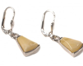 Silver earrings with transparent yellow amber