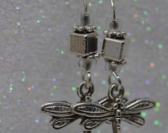 Beautiful handmade Dragonfly earrings with 925 sterling silver and glass bead details and findings.
