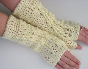 extra soft creme colored fingerless gloves with cable decoration
