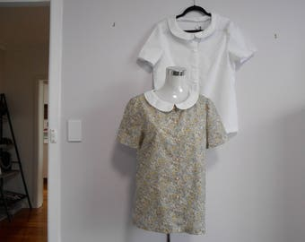 100% cotton semi-fitted blouse with peter pan collar, short sleeves, narrow hem. Available in a variety of fabrics.