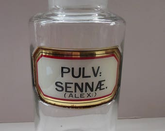 Large Antique Clear Glass Chemist Bottle. PULV: SENNAE (ALEX) with Original Foil Label and Ball Stopper. 8 3/4 inches