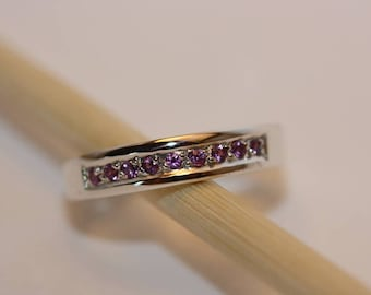 Small pink tourmalines set sterling silver ring