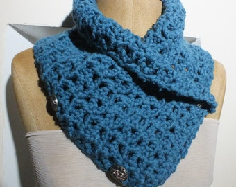 Crocheted cowl or neck warmer made with chunky yarn and featuring a 3-button fastening.
