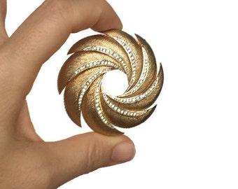 Kramer pinwheel brooch vintage gold tone rhinestone pin costume jewelry