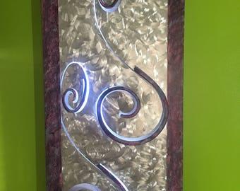 whimsical metal backlit wall hanging