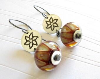 Boro glass lampwork boro bead earrings. Sterling silver handmade flower discs. Rustic finish. Quality artisan gift.  Gift for her.