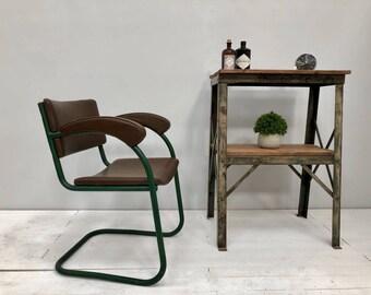 Original vintage industrial engineers arm chair. Mid century metal chair.