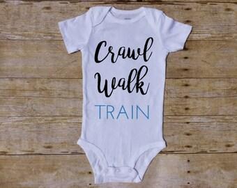 Triathlete baby, crawl walk train, triathlon mom, triathlon dad, ironman mom, ironman dad, future ironman, future athlete, future triathlete