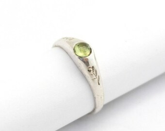 Medieval stirrup ring with gemstone