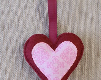 A handmade burgundy felt love heart hanging decoration