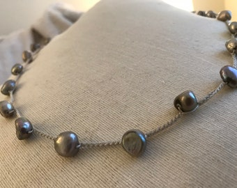 Pale gray freshwater pearls with shell clasp