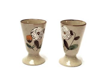Cups goblets on ground stoneware vintage flowers