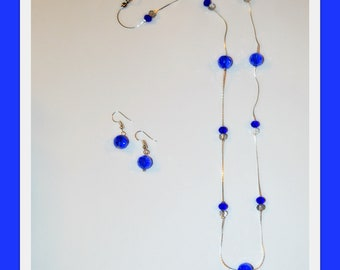 Blue sparkly crystal necklace and earring set.
