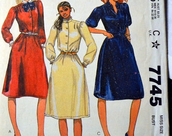 60c4e96b7d Vintage 1980 s Sewing Pattern McCall s 7745 Misses  Buttoned Pullover Dress  and Belt Bust 34 Size 12 Uncut Complete