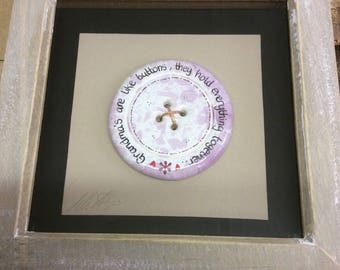 Handmade ceramic button in box frame
