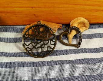 2 pendants charms hearts perforated, bronze