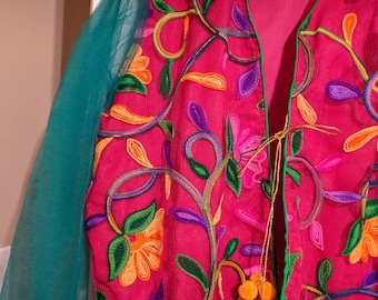 Hand embroidred multy color shiny net open jacket style with pom pom string.