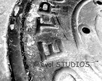 The Streets Of Eastern Market: Manhole Cover. Eastern Market, Detroit, Michigan. 8x10 Matted Black and White Art Photograph.