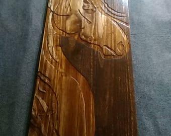 Equine profile on wood.