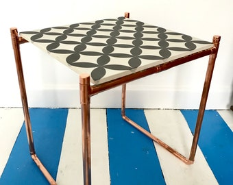 Copper side table with geometric tile