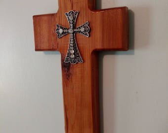 Wooden cross with rhinestone cross in center