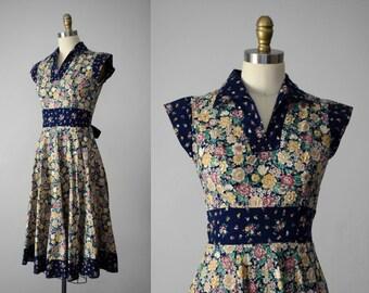 1970s vintage dress | vintage floral dress | fit and flare dress | tie back dress | cap sleeve dress | blue floral dress