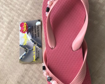 Bows on pink flip flops size 13