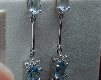 Hand made Sterling Silver and Blue Topaz Drop Earrings