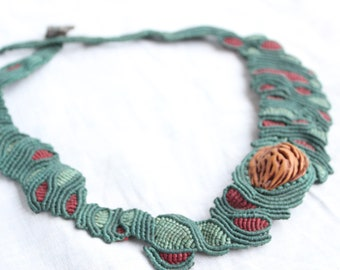Macrame natural asymmetric form Necklace with seed and Slag  from ancient mines