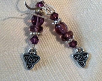 Amethyst Swarovski crystal and Sterling silver pierced earrings with Celtic knot Triad charms.
