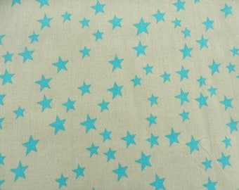 beige cotton fabric turquoise star