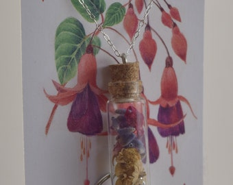 Beautiful dried wildflowers filled tiny bottle necklace