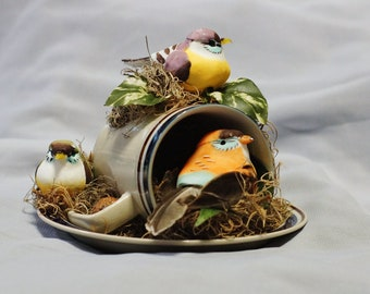 """These """"Three Little Birds"""", inspired by Bob Marley's song, are nestled in a light beige coffee mug waiting to perch in your home or office.."""