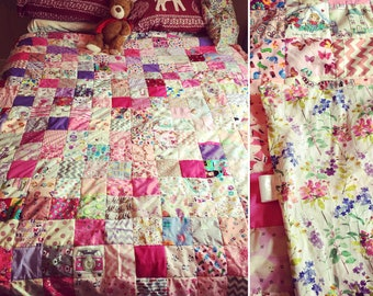 Pink floral bright themed family / adult or girlie patchwork quilt