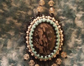 Fossilized stone pendant