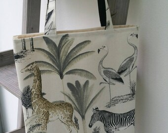 In the savanna giraffe Zebra theme tote bag