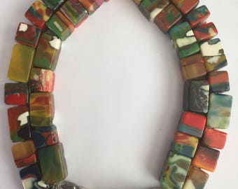 An Italian Vintage 1990's double strand acrylic necklace and matching cuff bracelet, designer